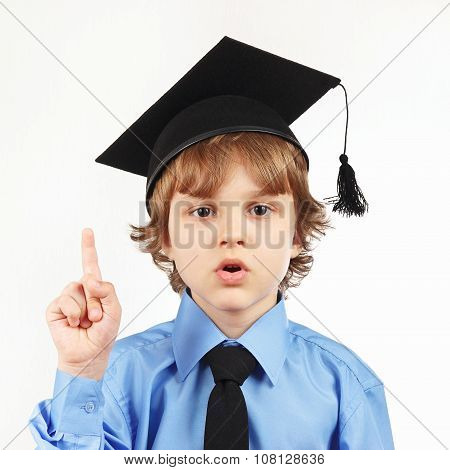 Little professor in academic hat on white background
