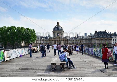 Paris, France - May 13, 2015: People Visit Institut De France And The Pont Des Arts Bridge