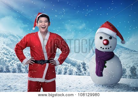 Asian Man In Sata Claus Costume In The Snow Field