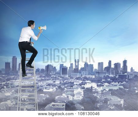 Asian Business Man Standing On The Ladder, Holding Megaphone