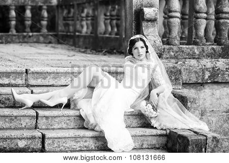 Bride Sitting On Stairs
