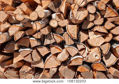 Rural Abstract Background With Stack Of Firewood.chopped Wood Stacked In Pile.