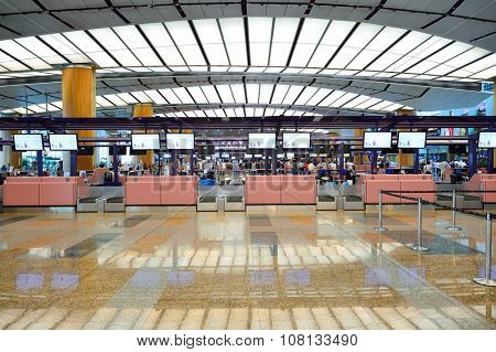 SINGAPORE - NOVEMBER 09, 2015: check-in zone at Changi Airport. Singapore Changi Airport, is the primary civilian airport for Singapore, and one of the largest transportation hubs in Southeast Asia