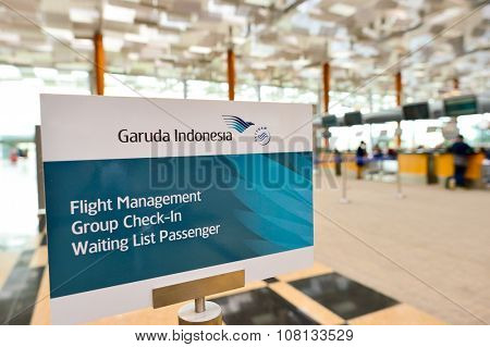 SINGAPORE - NOVEMBER 04, 2015: check-in zone at Changi Airport. Singapore Changi Airport, is the primary civilian airport for Singapore, and one of the largest transportation hubs in Southeast Asia