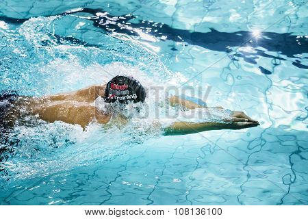 young swimmer breaststroke