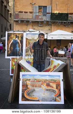 ROMA, ITALY-SEPT 24, 2015:  Proud man with thumb up showing his own painting at Navonna place the biggest place in Roma which is a nice example of Baroque Roman architecture  in Roma, Italy