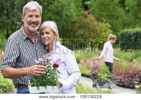 Portrait Of Mature Couple Shopping At Garden Center