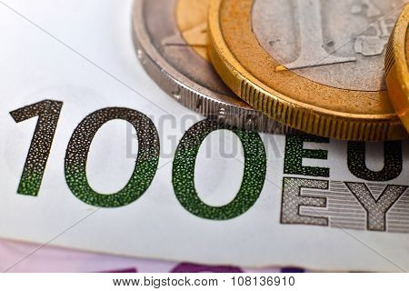Coins And One Hundred Euro Banknotes