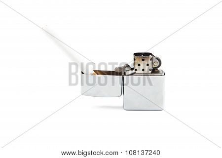 Cigarette and lighter on white background