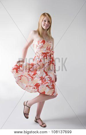 Model Posing In Orange Print Dress