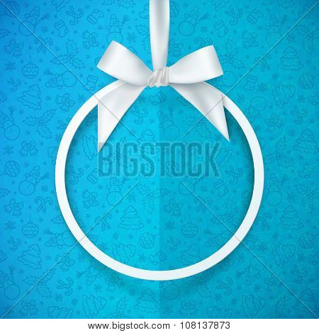 White holiday vround frame with bow and silky ribbon at blue Christmas doodle folded paper backgroun