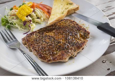 Pork steak with black pepper