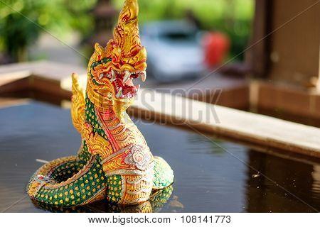 Naga statue rising on the pool