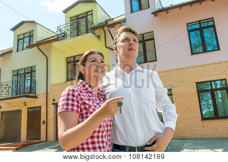 Happy Couple With The Keys In The Hands About His New Townhouse