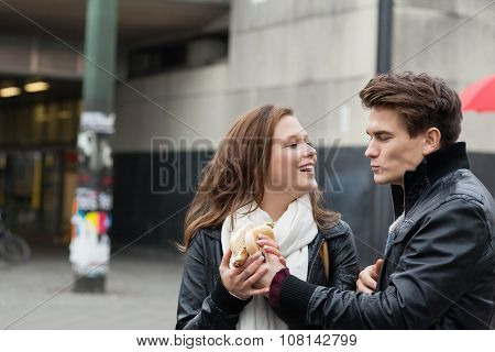 Couple In Jackets Holding Hot Dog