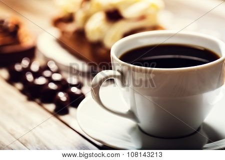 Cup Of Coffee With Assorted Desserts