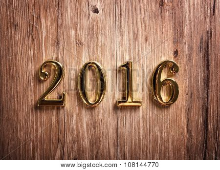 golden text 2016 on old wood background