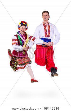 beautiful dancing couple in ukrainian polish national traditional costume clothes jumping, full leng