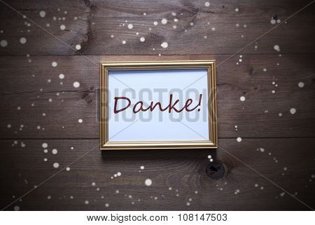 Golden Picture Frame With Danke Means Thank You And Snowflakes