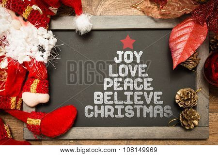 Blackboard with the text: Joy Peace Believe Christmas in a conceptual image