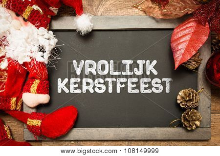 Blackboard with the text: Happy Christmas (in Dutch) in a conceptual image