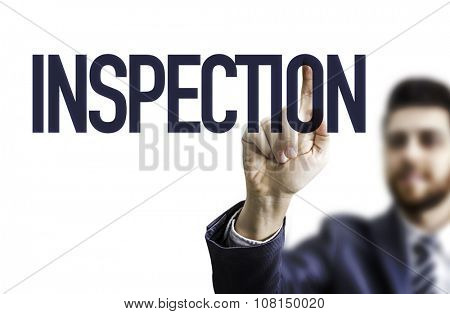 Business man pointing the text: Inspection