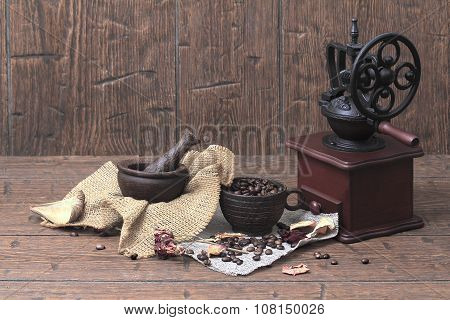 Vintage A Coffee Grinder, A Cup, A Mortar, Pestle  And Coffee Beans On Old  Homespun Canvas