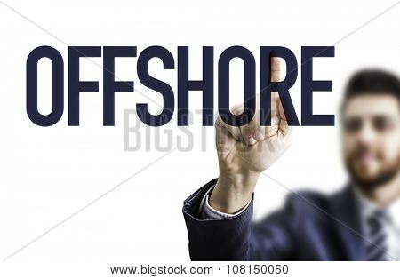 Business man pointing the text: Offshore