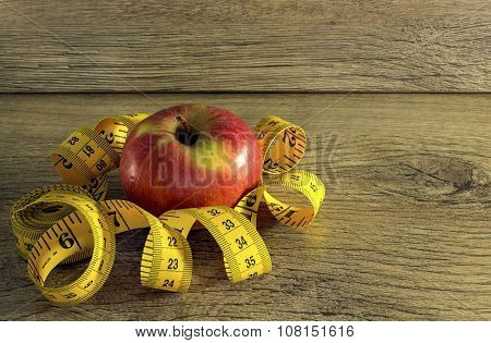 Measuring tape with apple
