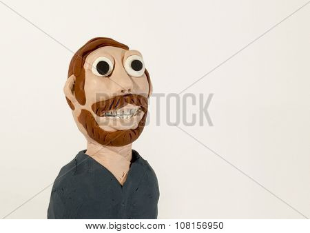 Plasticine character. Man with beard