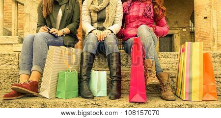 Three Girls Sitting And Chatting After Shopping In City  - Shopping And Tourism Concept - Warm Filte