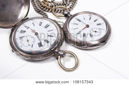 Antique pocket watches on white background.