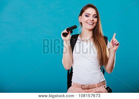 Tourist Woman With Binoculars On Blue