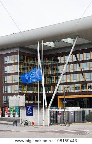 STRASBOURG FRANCE - 14 Nov 2015: European Union Flag flies at half-mast in front of the Counci lof Europe building Agora - following an terrorist attack in Paris