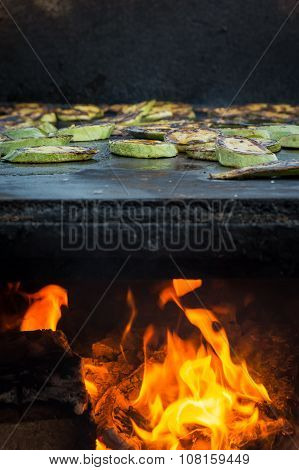 Fried courgette with cooking fire