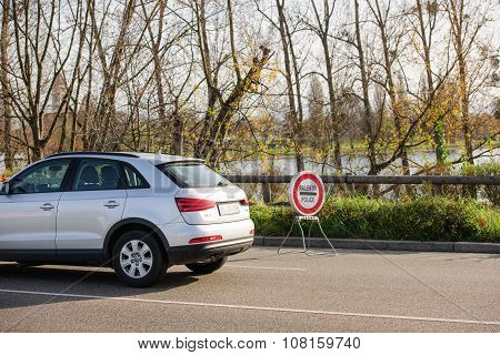 STRASBOURG FRANCE - NOV 14 2015: French Police checking vehicles on the 'Bridge of Europe' between Strasbourg and Kehl Germany as a security measure in the wake of attacks in Paris - slow down police sign