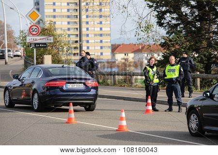 STRASBOURG FRANCE - NOV 14 2015: French Police with machine gun checking vehicles on the 'Bridge of Europe' between Strasbourg and Kehl Germany as a security measure in the wake of attacks in Paris