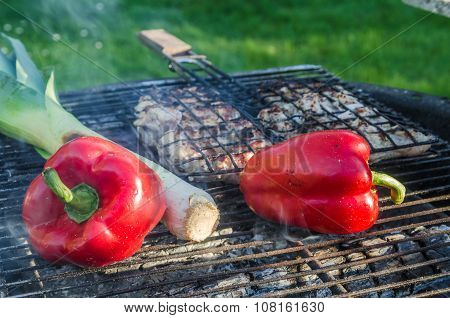Cooking Meat And Vegetables On The Grill