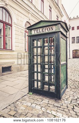 Old green retro street public call-box for telephone calls