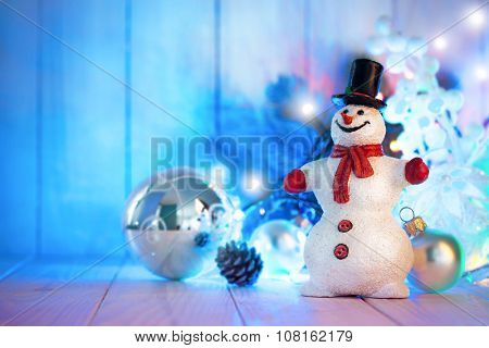 Christmas snowman with balls and garland on wooden board. Illustration