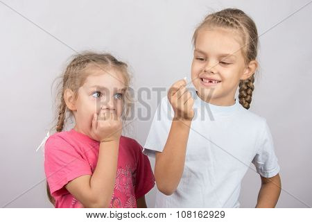Four-year Girl With The Fear Of Looking At The Lost Tooth In His Hand A Six-year Girl