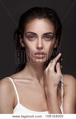 young adult woman with clean fresh skin and wet hair