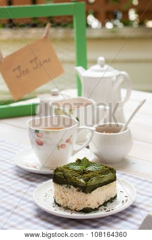 Green Tea Cake And A Cup Of Tea, Tea Set On White Wooden Board, Afternoon Tea Time