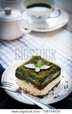 Japanese Matcha Green Tea Cake With A Cup Of Matcha Tea And Milk Jug, Asian Dessert