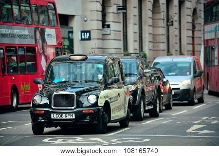LONDON, UK - SEP 27: Street with busy traffic on September 27, 2013 in London, UK. London is the world's most visited city and the capital of UK.
