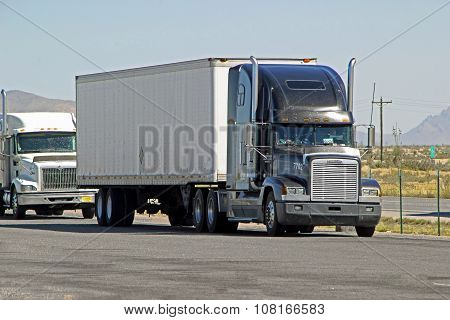 New Mexico, Usa - September 30: Big Semi Trailer Truck Driving Pulling Off Highway 2013