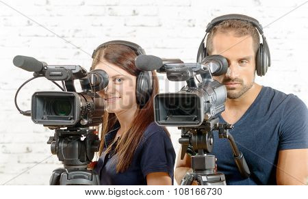 A Man And A Woman With Professional Video Camera