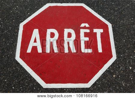 french Quebec stop sign painted on asphalt