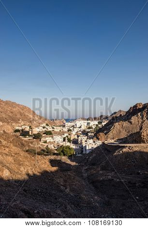 View of an old city situated in the mountain. Muscat, Oman.