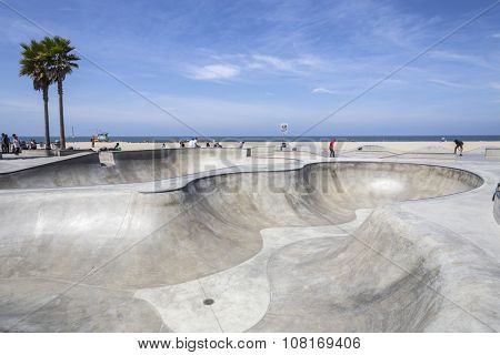 LOS ANGELES, CALIFORNIA , USA - June 20, 2014:  Concrete ramps and ocean views at the popular Venice beach skateboard park in Los Angeles, California.